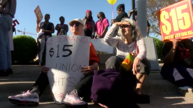 a prounion mixed group called for $15 per hour minimum wage including lgbt and black lives matter groups as well as duke university professors and... - ノースカロライナ州点の映像素材/bロール