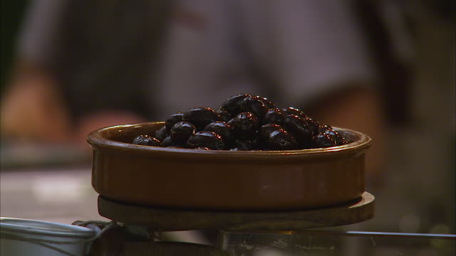 prunes on a wooden container - pflaume stock-videos und b-roll-filmmaterial