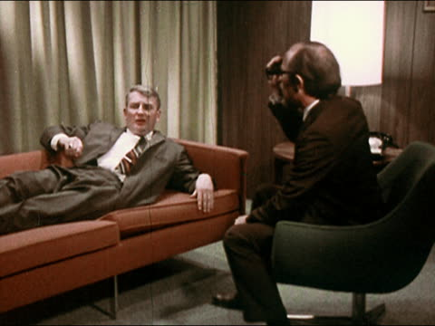 1969 psychiatrist counseling patient lying on couch - mental health professional stock videos & royalty-free footage