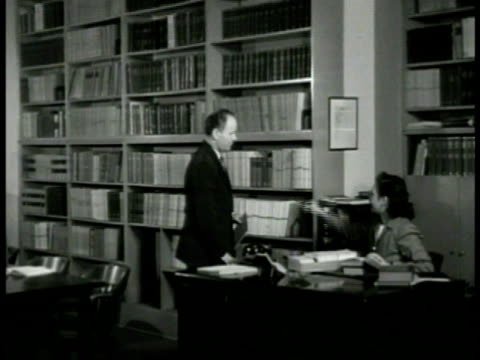 psychoanalytic inst building sign int ws doctor talking w/ librarian at desk in library going to books on shelves ms picture of sigmund freud cu... - librarian stock videos & royalty-free footage