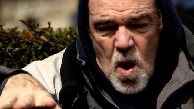 psychotic man in urban park - cu - psychosis stock videos & royalty-free footage