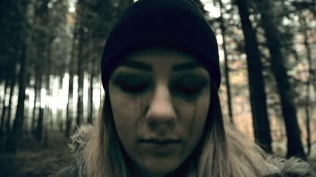 Psychotic young woman looking at the camera