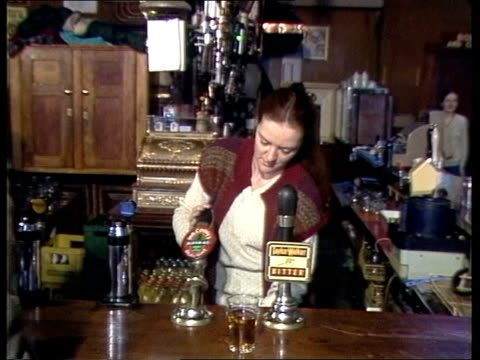 London Islington GV Kings Head PULL OUT CMS Sign 'King's Head' MS Bottle of beer sold to man CMS Till registers 10 2S6D MS Barmaid pulls pint for NIK...