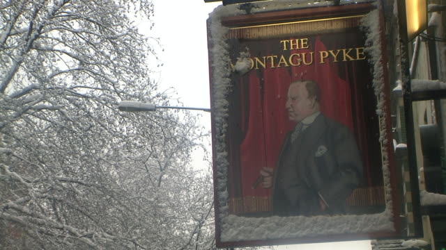 cu pub logo covered with snow, charing cross road, london, united kingdom - male likeness stock videos & royalty-free footage