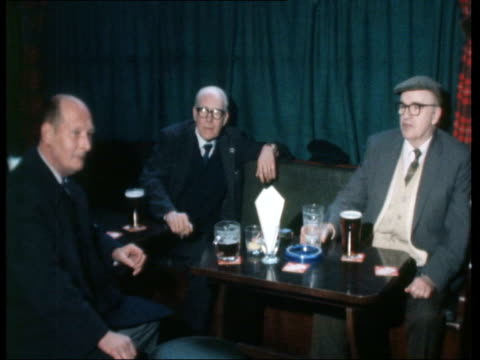 london a: nat story: men drinking: pan cooked food on bar to rolls and sandwiches in cabinet: cms pint drawn; pull out as served: pull out from men... - lunch stock videos & royalty-free footage