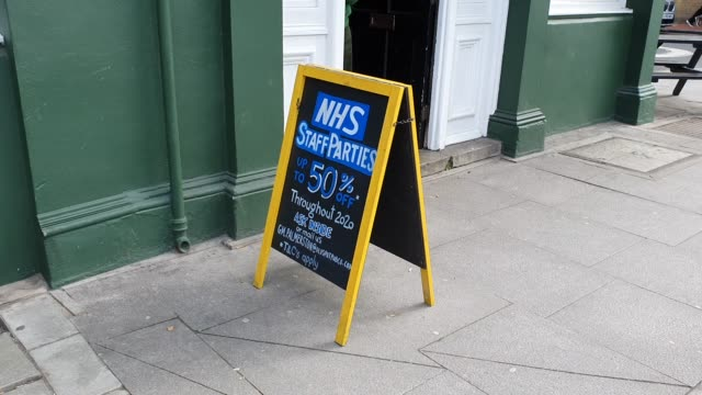 a pub offers 50% off for parties for nhs staff in east dulwich during the coronavirus pandemic on march 20 2020 in london england - brian dayle coronavirus stock videos & royalty-free footage