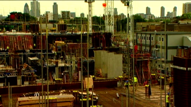 public borrowing reaches record level as country enters recession speeded up seq construction workers on scaffolded building on site then picture... - borrowing stock videos & royalty-free footage