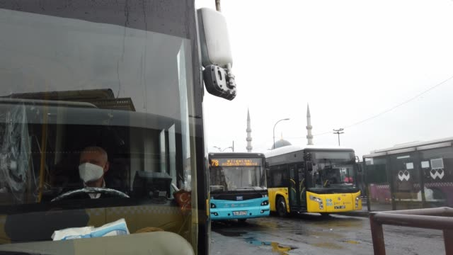 a public bus driver wearing a face mask waits passengers at the central bus station in eminonu during the coronavirus pandemic on april 04 2020 in... - bus driver stock videos & royalty-free footage