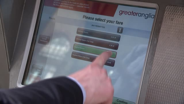 public consultation to be held on changes to train fares england london liverpool street station int hands touching ticket 'greater anglia' machine... - greater london stock videos and b-roll footage