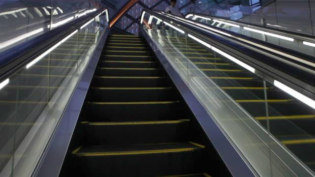 public escalator in shindome, tokyo, japan - steps stock videos & royalty-free footage