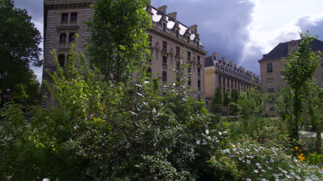 public gardens in front of building facades with a stormy sky april 28 2020 in paris france - storm cloud stock videos & royalty-free footage