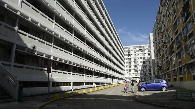 stockvideo's en b-roll-footage met public housing apartment block, developed by the hong kong housing authority, stands in the shek kip mei district of hong kong, china, on saturday,... - mei