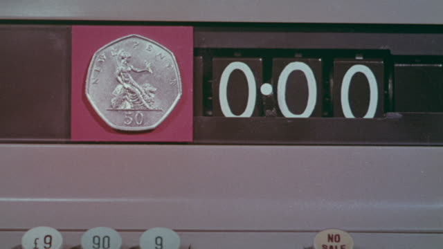 1971 montage public information about decimal currency with cash register and coins / united kingdom - 1971 stock-videos und b-roll-filmmaterial