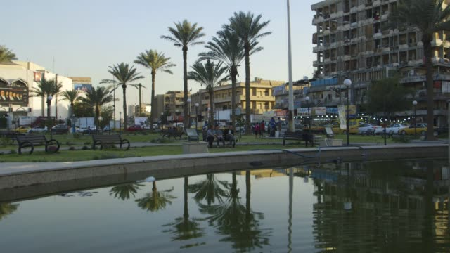 public park and pond in baghdad, tilt-up - baghdad stock videos & royalty-free footage