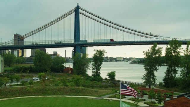public park and suspension bridge in toledo, ohio - aerial - suspension bridge stock videos & royalty-free footage