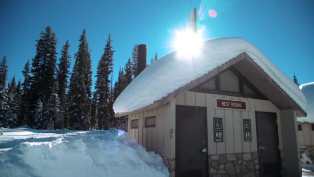 public restroom building outdoors in the snow with copy space - bathroom stock videos & royalty-free footage