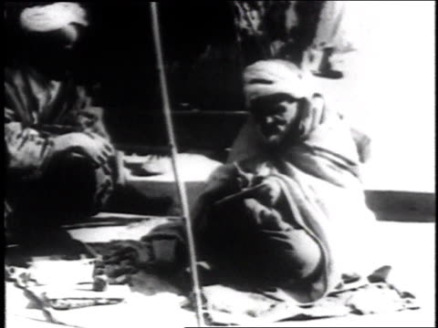 1936 ws public scribe sits on the street writing on a piece of paper - black and white stock videos & royalty-free footage