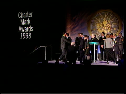 London Int Tony Blair shaking hands with people at Charter Mark Awards 1998 ceremony Tony Blair speech addressing public sector workers SOT Pay has...
