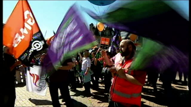 public sector strike goes ahead / government plans to clamp down on future strikes; west midlands: birmingham: striking workers waving flags - clamp stock videos & royalty-free footage