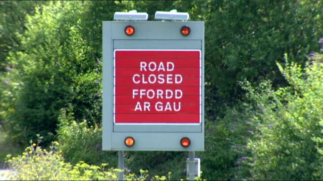 Public sector strike goes ahead / Government plans to clamp down on future strikes WALES Cardiff Sign 'Road Closed' SHOT along motorway