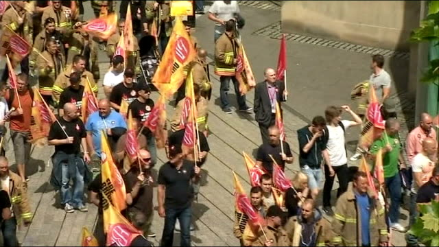 Public sector strike goes ahead / Government plans to clamp down on future strikes Newcastle Striking firefighters marching along