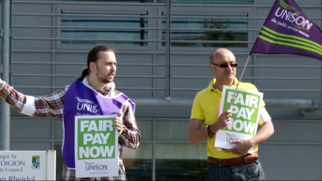 public sector strike goes ahead / government plans to clamp down on future strikes; wales: unison representatives posing with 'fair pay now' signs at... - clamp stock videos & royalty-free footage