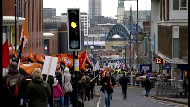 millions of workers support oneday strike striking public sector workers march along road towards tyne bridge in distance - tyne bridge stock videos & royalty-free footage