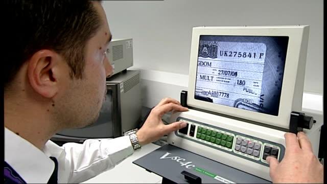 threat to heathrow airport immigration service int various shots of passengers and staff at uk border agency passport control desks uk border agency... - zoll und einwanderungskontrolle stock-videos und b-roll-filmmaterial