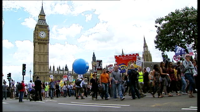 unions react angrily to government threats T30061113 Various views of strikers marching through Parliament Square with Big Ben in the background