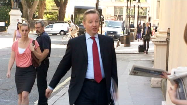 public sector workers prepare for national strike over pension reforms; london: michael gove mp along and being given newspaper in street michael... - newspaper strike stock videos & royalty-free footage