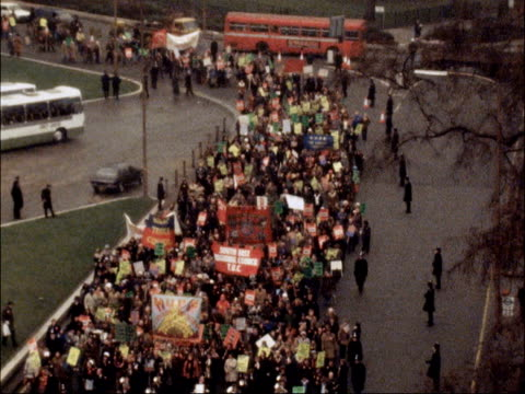 demonstration march in london england london head of march to tilt up sof band / ts pan march lr up buckingham palace road / ms march along lr at... - 1979 stock videos and b-roll footage