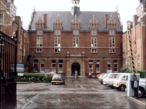 "hospital services cut in london borough of lambeth; england: london: lambeth: ext general view of lambeth town hall / poster reading ""lambeth march... - dulwich stock videos & royalty-free footage"
