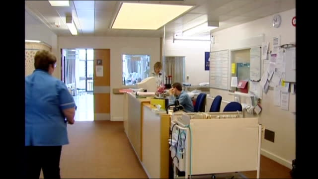 Six thousand mental health trust jobs at risk ENGLAND Devon Royal Devon and Exeter Hospital Ward desk and staff about Close Shot of sticker being...