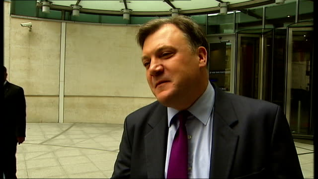 Russell Brand and Ed Balls doorstep intvs ENGLAND London BBC Broadcasting House EXT Russell Brand comments to reporter as leaving BBC Brioadcasting...