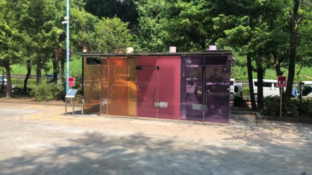public toilet made of coloured smart glass which turns opaque when the cubicle is locked on august 19, 2020 in tokyo, japan. the toilet, designed by... - transparent stock-videos und b-roll-filmmaterial
