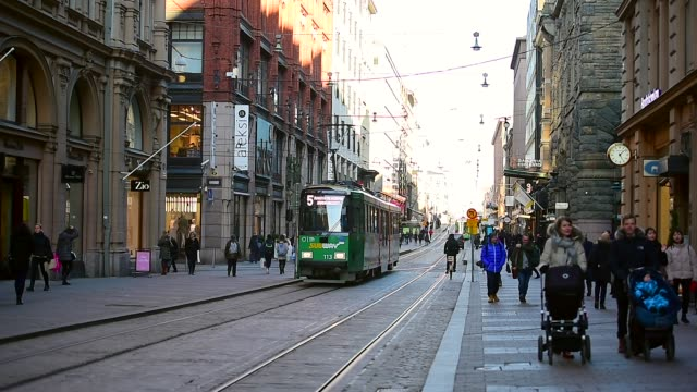 public transport, retro tram in city center of helsinki, finland - finlandia video stock e b–roll