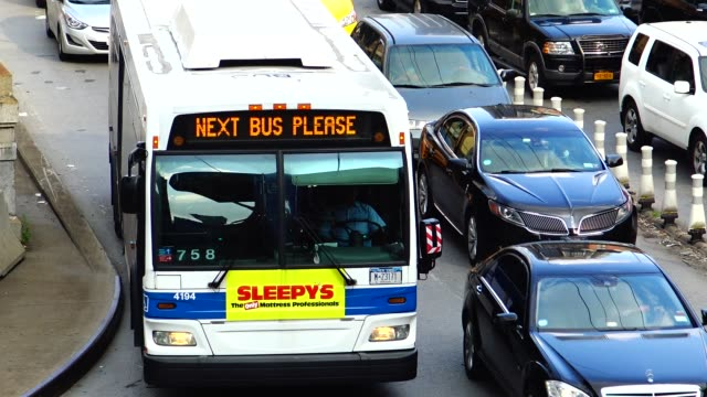 q32 mta public transportation bus exiting the ed koch queensboro 59th street bridge onto 2nd avenue 60th street in midtown manhattan / the q32 bus... - new york city penn station stock videos and b-roll footage