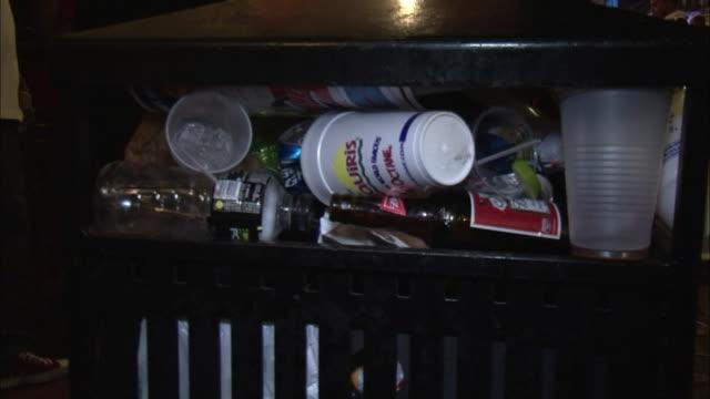 a public trashcan overflows with trash. - いっぱいになる点の映像素材/bロール