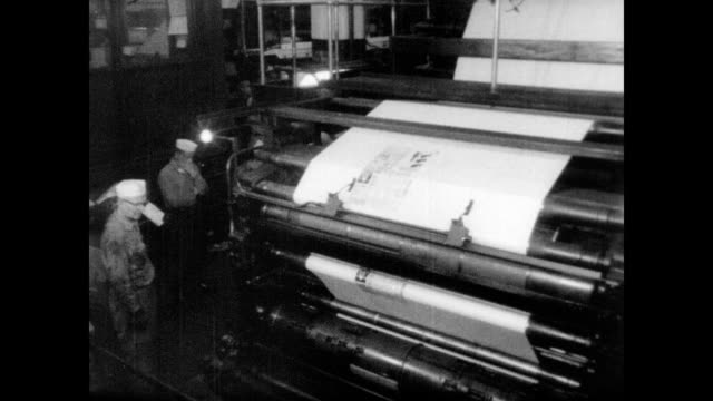 / publication closes down after 8 months / newspapers moving along printing presses / worker holds up newspaper for camera / newspaper headline and... - printing press stock videos & royalty-free footage