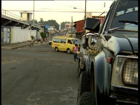 publicity car with rooftop mounted speakers drives along busy street trinidad and tobago - bbc news bildbanksvideor och videomaterial från bakom kulisserna