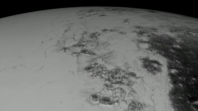 nasa publish a video consisting of the photos of the dwarf planet pluto in united states of america on 22 september 2015 this synthetic perspective... - 2010年代点の映像素材/bロール