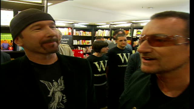 U2 publish new book 'U2 by U2' Back view of Bono as joins Sylvester and The Edge The Edge and Bono listen to reporter Back view of Bono as reporter...