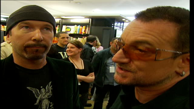 publish new book 'u2 by u2'; back view of bono as listens to reporter bono interview sot - megalomania started at a very early age and always the... - ボブ・マーリー点の映像素材/bロール