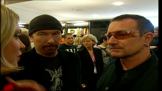 u2 publish new book 'u2 by u2' back view of bono as reporter asks question bono and the edge listen to question back view of bono as listens to... - david 'the edge' howell evans stock videos and b-roll footage