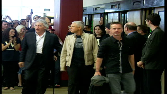 u2 publish new book 'u2 by u2' **beware london int members of u2 towards from lift the edge larry mullen and adam clayton at photocall tilt down bono... - david 'the edge' howell evans stock videos and b-roll footage