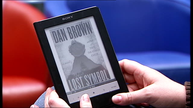 Apple and five publishers accused of colluding to fix ebook prices T18100910 GERMANY Frankfurt Hands holding Sony ebook reader