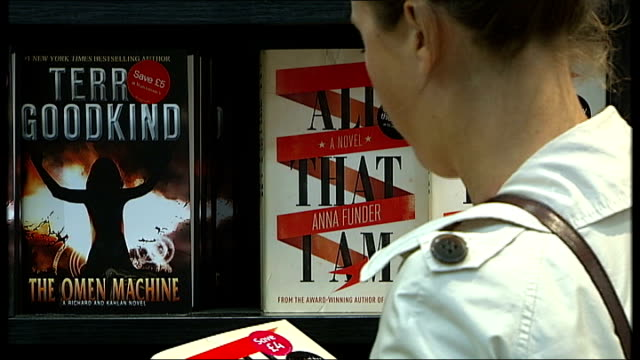 sales of hardback books in decline as ebooks take over england london waterstone's piccadilly int shots of shoppers browsing books in book store back... - hardcover book stock videos and b-roll footage