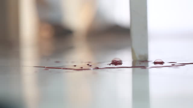 a puddle of blood on the floor and a man standing at the door - reenactment stock videos & royalty-free footage