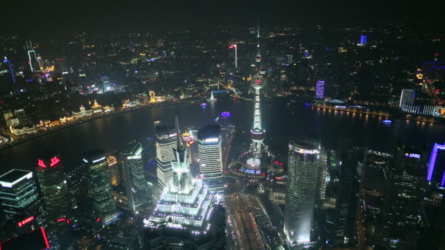 ws ha pudong and  bund skyline with huangpu river and pearl tower at night - river huangpu stock videos & royalty-free footage
