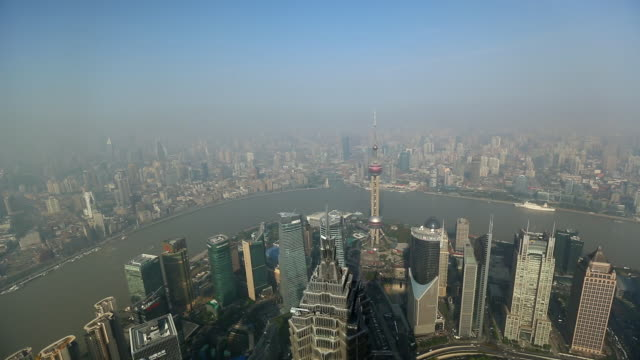 ws ha pudong and  bund skyline with huangpu river and pearl tower - river huangpu stock videos & royalty-free footage